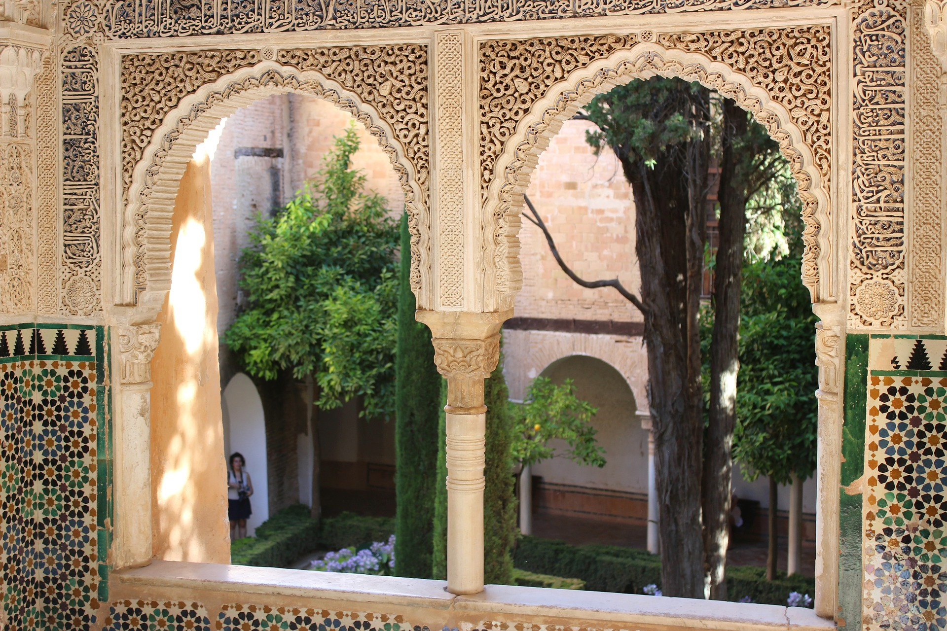 Window view in Alhambra - arches and arabesque